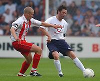 Fotball<br /> 20.07.2004<br /> Premier League<br /> Foto: SBI/Digitalsport<br /> NORWAY ONLY<br /> <br /> Stevenage Borough v Tottenham Hotspur. Pre season friendly.  20/7/04<br /> <br /> Stevenage Borough's Mark Rogers and Tottenham Hotspur's Robbie Keane