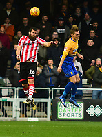 Lincoln City's Michael Bostwick clears under pressure from  Mansfield Town's Danny Rose<br /> <br /> Photographer Andrew Vaughan/CameraSport<br /> <br /> The EFL Sky Bet League Two - Lincoln City v Mansfield Town - Saturday 24th November 2018 - Sincil Bank - Lincoln<br /> <br /> World Copyright © 2018 CameraSport. All rights reserved. 43 Linden Ave. Countesthorpe. Leicester. England. LE8 5PG - Tel: +44 (0) 116 277 4147 - admin@camerasport.com - www.camerasport.com