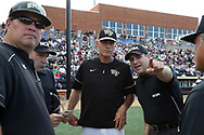 WINSTON-SALEM, NC - JUNE 02: Wake Forest head coach Tom Walter (center) and UMBC head coach Bob Mumma (left) listen to third base umpire Ryan Morehead (right) explain the ground rules. The Wake Forest Demon Deacons hosted the University of Maryland Baltimore County Retrievers on June 2, 2017, at David F. Couch Ballpark in Winston-Salem, NC in NCAA Division I College Baseball Tournament Winston-Salem Regional Game 2. Wake Forest won the game 11-3.