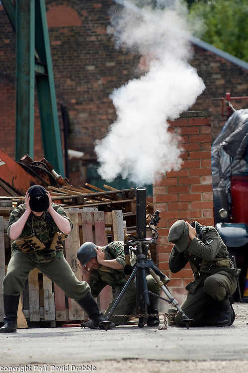 Reenactors take part in a firing display as a Mortar team of the Panzer Grenadier Division Großdeutschland at<br /> Elsecar 1940s Weekend <br /> 4 September 2010<br /> Images © Paul David Drabble