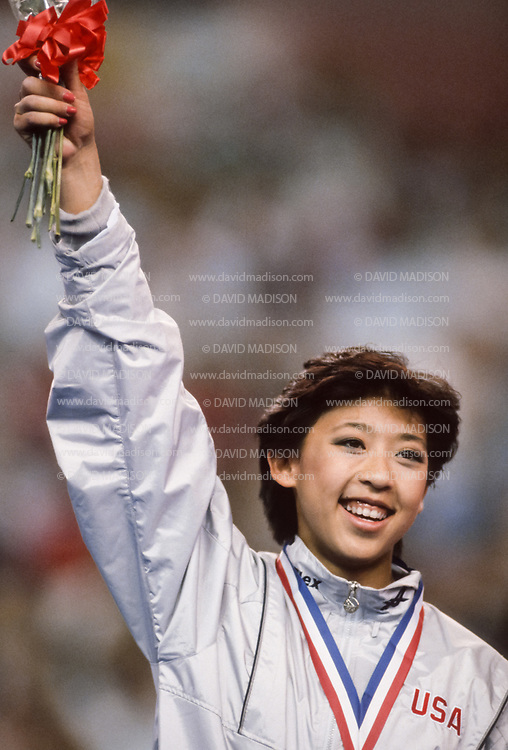 PHOENIX - APRIL 24:  Sabrina Mar of the USA waves to the crowd during a USA - USSR gymnastics meet on April 24, 1988  at the Arizona Veterans Memorial Coliseum in Phoenix, Arizona.  (Photo by David Madison/Getty Images)