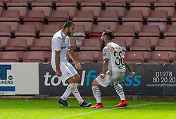 WREXHAM, WALES - Thursday, September 17, 2020: FC Dinamo Tbilisi's Giorgi Gabedava (L) celebrates with team-mate Nodar Kavtaradze (R) after scoring an injury time penalty to seal a 1-0 victory during the UEFA Europa League Second Qualifying Round match between Connah's Quay Nomads FC and FC Dinamo Tbilisi at the Racecourse Ground. Dinamo Tiblisi won 1-0. (Pic by David Rawcliffe/Propaganda)