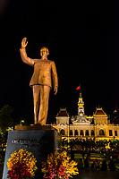 Statue of Ho Chi Minh with Hotel de Ville (Ho Chi Minh CIty Hall) behind, HCMC Ho Chi Minh City (Saigon), Vietnam.