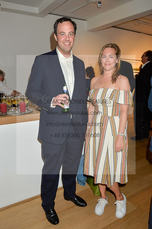 LORD BUCKHURST and ALICE CADESTIN at a private view of photographs by Jolyon Fenwick 'The Zero Hours Panoramas' 100 Years On: Views From The Parapet of The Somme held at Sladmore Contemporary, 32 Bruton Place, London on 30th June 2016.