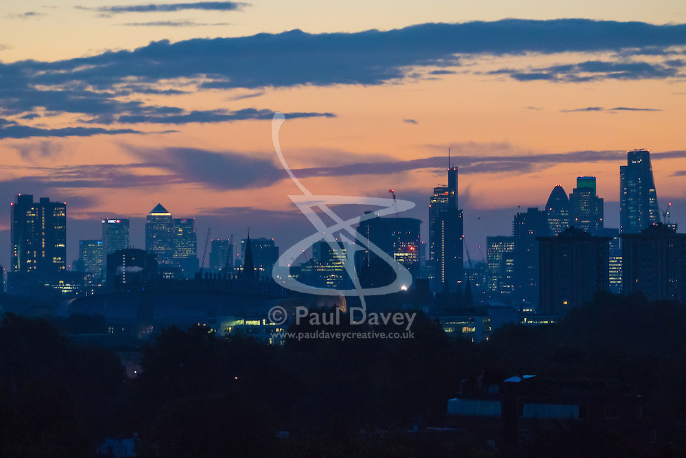 Primrose Hill, London, October 28th 2016. The early morning light creates gentle hues as dawn breaks over London.