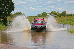 A car fords a small creek crossing on the road from the Broome highway down to Fitzroy Crossing after rain.
