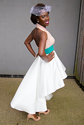 LIVERPOOL, ENGLAND - Friday, April 4, 2014: Dayo Adetunji from London with a dress she designed herself during Ladies' Day on Day Two of the Aintree Grand National Festival at Aintree Racecourse. (Pic by David Rawcliffe/Propaganda)
