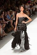 Gown with a black and white animal print skirt with organza overlay and pieced and pleated top. By Carlos Miele at the Spring 2013 Mercedes-Benz Fashion Week in New York.