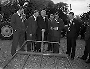 10/05/1962<br /> 05/10/1962<br /> 10 May 1965<br /> Opening of Smiths Motor Group Garage Athy, Co. Kildare. Picture shows the Minister for Agriculture, Mr. Patrick Smith, (third from left) admiring a Cavan (Ballieborough) built Corrig Fork Lifter during his tour of the garage. In the picture are (l-r): Mr. A.C. Hill, Marketing Manager, Caltex (Ireland) Ltd.;  Mr John Beatly, Chief Inspector, Dept. of Agriculture; Mr Smith; Mr. P.G. Dooley, T.D.; Mr. C.A. Smith, Chairman of the Smith Motor Group and Mr John Perry, Manager of Athy Garage, Smith Motor Group.