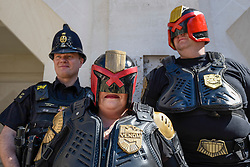 © Licensed to London News Pictures. 08/04/2017. London, UK. A woman dressed as Venom (C) and Judge Dredd (R) stand with a real City of London police as they join participants taking part in the inaugural Games Character Parade, walking from Guildhall to Paternoster Square.  The event formed part of the London Games Festival welcoming cosplayers, wearing costumes inspired by videogame characters, to the UK's biggest parade of cosplayers.   Photo credit : Stephen Chung/LNP