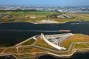 Nederland, Zuid-Holland, Nieuwe Waterweg, 23-05-2011; Maeslantkering in de Nieuwe Waterweg, gezien naar het Westland. De stormvloedkering bestaat uit twee deuren die klaar liggen in een dok en welke sluiten bij een waterstand van 3 meter of meer boven NAP. De kering, laatst voltooide onderdeel van Deltawerken, beschermt Rotterdam en achterland bij extreme waterstanden..The new storm surge barrier (Maeslantkering) in the Nieuwe Waterweg (New Waterway, the entrance to the port of Rotterdam)..In case of storm floods, the two enormous doors will close of the waterway protecting Rotterdam and its hinterland.luchtfoto (toeslag); aerial photo (additional fee required).foto Siebe Swart / photo Siebe Swart