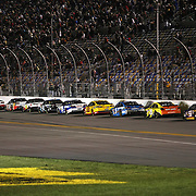 Kevin Harvick (29) leads the race as the drivers head down the front stretch during the NASCAR Sprint Unlimited Race at Daytona International Speedway on Saturday, February 16, 2013 in Daytona Beach, Florida.  (AP Photo/Alex Menendez)