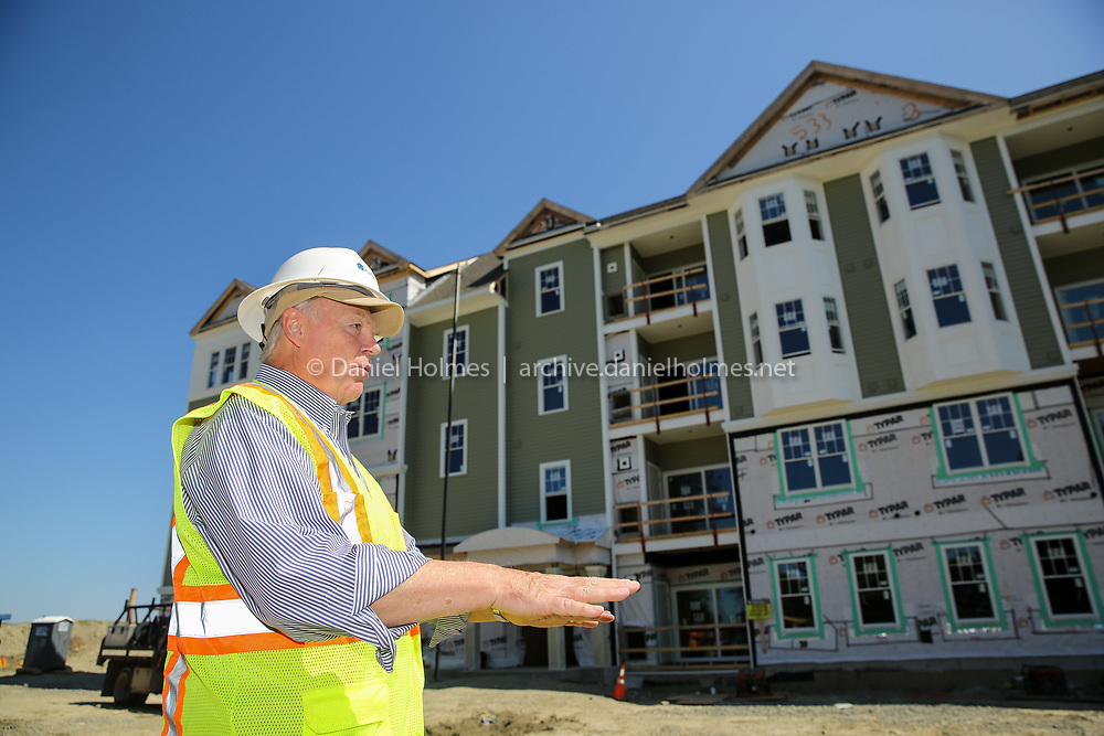 (8/12/19, WESTBOROUGH, MA) Reid Blute, of Pulte Homes, shows some of the new over 55 housing being built at the site of the old Westborough State Hospital in Westborough on Monday. [Daily News and Wicked Local Photo/Dan Holmes]