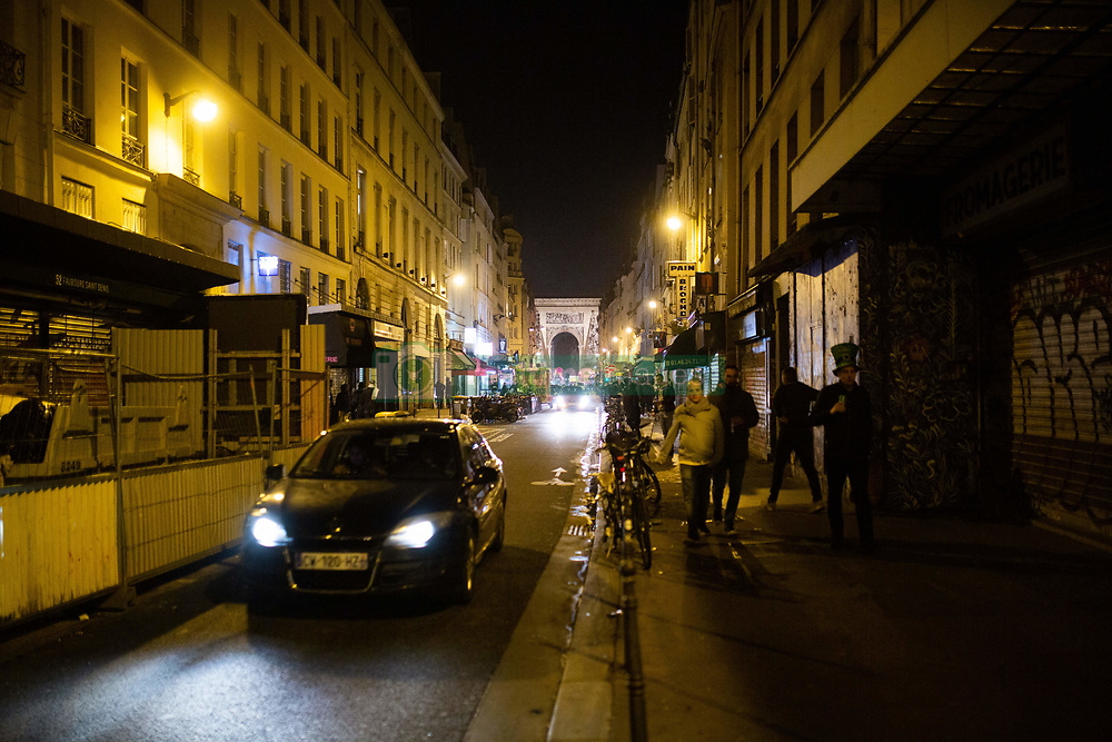 The street of rue du faubourg saint denis at midnight with bar closing in Paris, on March 14, 2020. France on March 14, 2020 drastically stepped up its measures against the spread of the coronavirus, announcing the closure of all non-essential public places including restaurants, bars and cafes from midnight. Photo by Raphael Lafargue/ABACAPRESS.COM