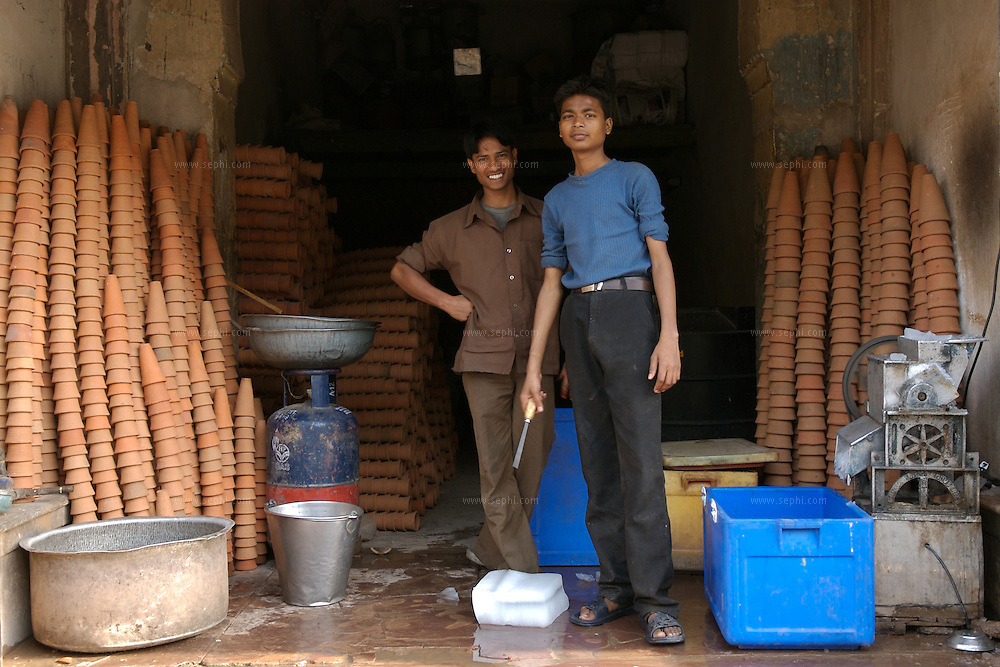 Two young men stack up the crushed ice and the kulhars next to a favorite lassi spot on M.I. Road, Jaipur, April 2007