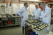 Technicians and managers taste new biscuit product in the experimental kitchen of the Delacre production factory in Lambermont