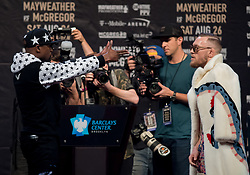 July 13, 2017 - Brooklyn, New York, USA - FLOYD MAYWEATHER and CONOR MCGREGOR stare each other down at a press conference at the Barclays Center in Brooklyn. (Credit Image: © Joel Plummer via ZUMA Wire)