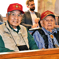 Navajo Code Talker Association President Peter MacDonald, a former Navajo Nation chairman, and Navajo Code Talker Association Vice President Samuel Sandoval made a surprise visit to the Navajo Council summer session. And as soon as Speaker Seth Damon announced their presence, delegates walked to where they were sitting to shake their hands.