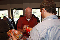 I spent an afternoon with the staff and their special guests at Jones and Salt Insurance during their annual sandwich making event for The Mustard Seed. They brought in 300 loaves of bread and severa huge buckets of peanut butter and jam and turned it all into sandwiches to donate. The sandwiches are used in the bagged lunches that the guests of the Mustard Seed take with them when they leave for the day. The event was lots of fun and it was really great to be able to participate and help out.<br /> <br /> ©2013, Sean Phillips<br /> http://www.RiverwoodPhotography.com