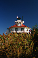 Solomon's Island, Maryland--Drum Point Light is one of three surviving Chesapeake Bay screw-pile lighthouses. Originally located off Drum Point at the mouth of the Patuxent River, it is now on display at the Calvert Marine Museum.