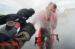 March 23, 2018 - Tanjung Malim, Malaysia - Andris Vosekalns enjoys the water curtain at the finish line of the sixth stage, the 108.5km from Tapah to Tanjung Malim, of the 2018 Le Tour de Langkawi. .On Friday, March 23, 2018, in Tanjung Malim, Malaysia. (Credit Image: © Artur Widak/NurPhoto via ZUMA Press)