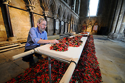 Licensed to London News Pictures 04/11/2016<br /> Hull-based artist Martin Waters puts the finishing touches to his poppy installation 'Wounded' at Beverley Minster, East Yorkshire.  Made from hundreds of poppies it remembers the work of the stretcher bearers, nursing and medical staff of World War One and World War Two.<br /> <br /> It's on display in the Minster from 1-20 November.<br /> Photo Credit: Sam Atkins/LNP