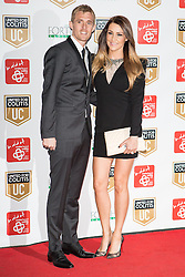 © Licensed to London News Pictures . 27/03/2014 . Manchester , UK . Darren Fletcher (l) arrives at a gala dinner at Manchester United Football Club in support of United for Colitis , in aid of Crohn's And Colitis UK . Photo credit : LNP