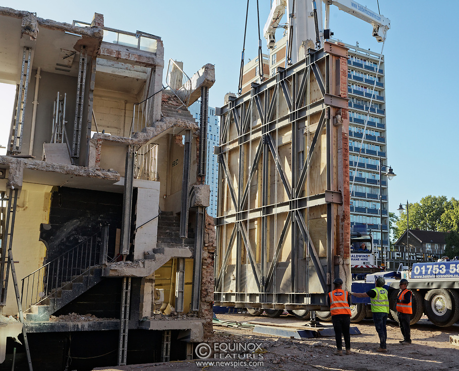 London, United Kingdom - 20 September 2019<br /> EXCLUSIVE SET - Aerial construction specialists and demolition experts use a huge crane to carefully lift intact, a twenty five ton, two-story wall, to preserve a famous Banksy rat image which has been covered up for years. Teams from specialist companies have spent over six weeks cutting around the artwork and fitting custom made eight ton steel supports to enable them to save the historic piece of art. Work has started on the construction of a new twenty seven floor art'otel hotel on the site of the old Foundry building in Shoreditch, east London, and a condition of the planning permission was to preserve the historical Banksy graffiti. A second section of the painting, an image of a TV being thrown through a broken window has already been cut out and moved separately. After the hotel construction is complete the two parts of the Banksy painting will be displayed on the hotel. Our pictures show the stages of work to protect the image, culminating in the lifting of the three story wall by crane. Video footage also available.<br /> (photo by: EQUINOXFEATURES.COM)<br /> Picture Data:<br /> Photographer: Equinox Features<br /> Copyright: ©2019 Equinox Licensing Ltd. +443700 780000<br /> Contact: Equinox Features<br /> Date Taken: 20190920<br /> Time Taken: 17114530<br /> www.newspics.com
