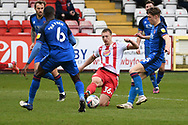 Carlisle United defender Aaron Hayden (6) Stevenage forward Luke Norris (36) and Carlisle United defender Max Kilsby (35) battles for possessionduring the EFL Sky Bet League 2 match between Stevenage and Carlisle United at the Lamex Stadium, Stevenage, England on 20 March 2021.