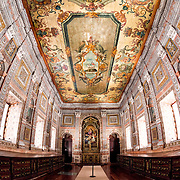 "LISBON, Portugal - The Sacristy was completed in 1716 and its walls are covered in polychrome marble inlays. The ceiling is decorated with an oil on canvas painting that features an ""Agnus Dei"" (Lamb of God) in its center, surrounded by profuse floral decoration with allegories of the Canons Regular of St. Augustine and the City of Lisbon. The long wooden chests lining each side are made of Brazilian jacaranda and are designed to store the sacred vestments. Under the floor are 12th century anthropomorphic tombs that were discovered during restoration work. They are the tombs of the Teutonic crusaders who helped the first king, Afonso Henriques, in the conquest of Lisbon. The Monastery of São Vicente de Fora is a 17th-century church and monastery in the Alfama neighborhood of Lisbon. It features ornately decorated sections in the Baroque style as well as the Braganza Pantheon, where the kings who ruled Portugal between 1640 and 1910 are interred."