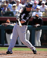 SCOTTSDALE, AZ - MARCH 09:  Adam Dunn #32 of the Chicago White Sox singles against the San Francisco Giants on March 09, 2011 at Scottsdale Stadium in Scottsdale, Arizona. The Giants defeated the White Sox 4-2. (Photo by Ron Vesely)