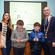 05/03/2019<br /> Pictured are award winners Shane Collins and Mark O'Sullivan from St Mary's Boys NS, Abbeyfeale, along with Sara Montoya, co-op member of Fairtrade Colombia, and Cllr Daniel Butler, Mayor of the Metropolitan District of Limerick.<br /> <br /> Fairtrade worker Sara Montoya, from a Fairtrade Coffee Co-op in Colombia was the special guest in Limerick City and County Council chamber today at an event to coincide with Fairtrade Fortnight.<br />  <br /> Sara joined Fairtrade supporters from across Limerick and Ireland for the annual initiative, which features a programme of talks and community events aimed at promoting awareness of Fairtrade and Fairtrade-certified products.<br />  <br /> Speaking at the event in Dooradoyle, Sara outlined the success and benefits of the Fairtrade movement in Colombia and how important it is for people in the developed world think of Fairtrade products when shopping.<br />  <br /> This year's campaign 'Create Fairtrade' invites us all to use our imagination and create fairtrade in our lives.<br />  <br /> Young people from across Limerick city and county were also a focus of the event as they displayed their posters, which they created to help change the way people think about trade and the products on our shelves.<br /> Photo by Diarmuid Greene