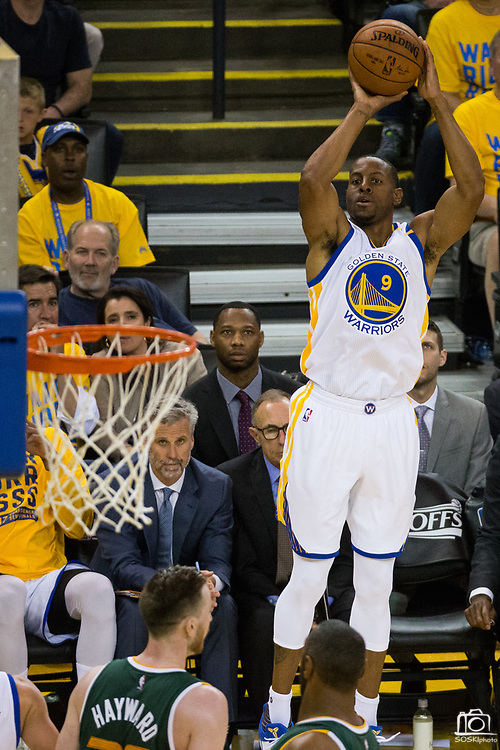 Golden State Warriors forward Andre Iguodala (9) shoots a three pointer against the Utah Jazz during Game 1 of the Western Conference Semifinals at Oracle Arena in Oakland, Calif., on May 2, 2017. (Stan Olszewski/Special to S.F. Examiner)