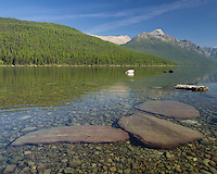 Bowman Lake is located on the north side of Glacier National Park. It is long and skinny, and quite shallow along the edges, which allowed me to wade in and get this picture.