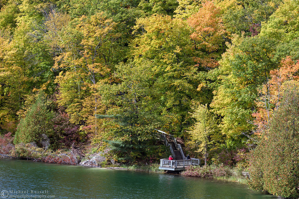 """A viewing platform along the Pink Lake Trail loop at Pink Lake (Lac Pink) in Gatineau Park, Québec, Canada.  Photographed during the """"Fall Rhapsody"""" festival celbrating fall foliage colours in Gatineau Park."""