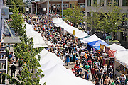 Crowds fill the street during the Fremont Fair in Seattle, Washington.