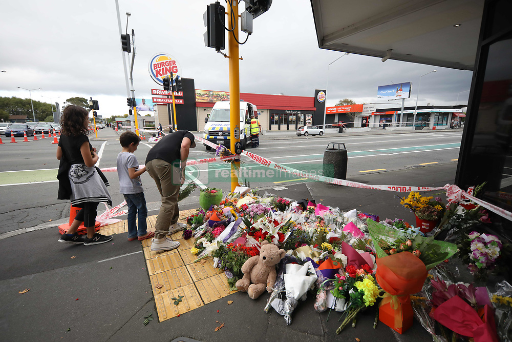 March 17, 2019 - Christchurch, New Zealand - People place flowers and messages of condolence to victims of the mosque attacks outside the Linwood Masjid mosque in Christchurch on March 16, 2019. At least 49 people dead and more than 40 people injured following attacks on two mosques in  Christchurch. The national security threat level has been increased from low to high for the first time in New Zealand's history after this attack. (Credit Image: © Sanka Vidanagama/NurPhoto via ZUMA Press)