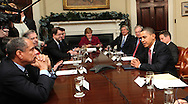 President Barack Obama talks into a speaker phone to CEO's in New York as he meets with members of the financial services industry on December 14, 2009. right to left:  President Obama, Secretary Geithner, Jim Rohr, PNC James Dimon, JP Morgan, Christina Romer,  (not identified-not seen,) Robert Kelly, Bank of New York  Ronald Logue, State Street, Ken Chenault, AMEX . ) Photo by Dennis Brack