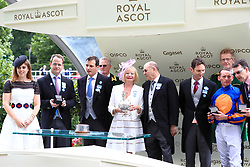 Winning connections of September are presented with prizes by Princess Beatrice of York after winning the Chesham Stakes with horse Idaho
