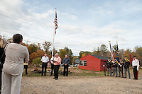 Gilford Chairman John O'Brien addresses the crowd during the Flagpole dedication at Gilford Outing Club/Warming Hut on Tuesday afternoon in honor of first responders.   (Karen Bobotas/for the Laconia Daily Sun)
