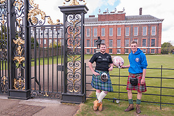© Licensed to London News Pictures. 03/05/2015. London, UK. Scottish rugby fans, Blair (left) and Ross (right), in the capital to watch yesterday's European rugby union final at Twickenham, take in the sights today and are amongst the well-wishers outside Kensington Palace to show support for the new daughter of the Duke and Duchess of Cambridge who was born the previous day. Photo credit : Stephen Chung/LNP