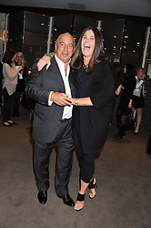 SIR PHILIP GREEN and ELIZABETH SALTZMAN at the launch of Samsung's NX Smart Camera at charity auction with David Bailey in aid of Marie Curie Cancer Care at the Bulgari Hotel, 171 Knightsbridge, London on 14th May 2013.