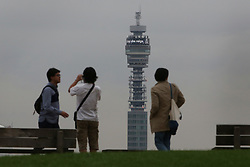 © Licensed to London News Pictures. 09/09/2015.  London, UK. People look out from Primrose Hill as the BT Tower carries a message for Queen Elizabeth II  'Long May She Reign'. Today Queen Elizabeth II becomes the United Kingdom's longest serving monarch as he passes Queen Victoria's 23,226 days on the throne.  Photo credit: Peter Macdiarmid/LNP