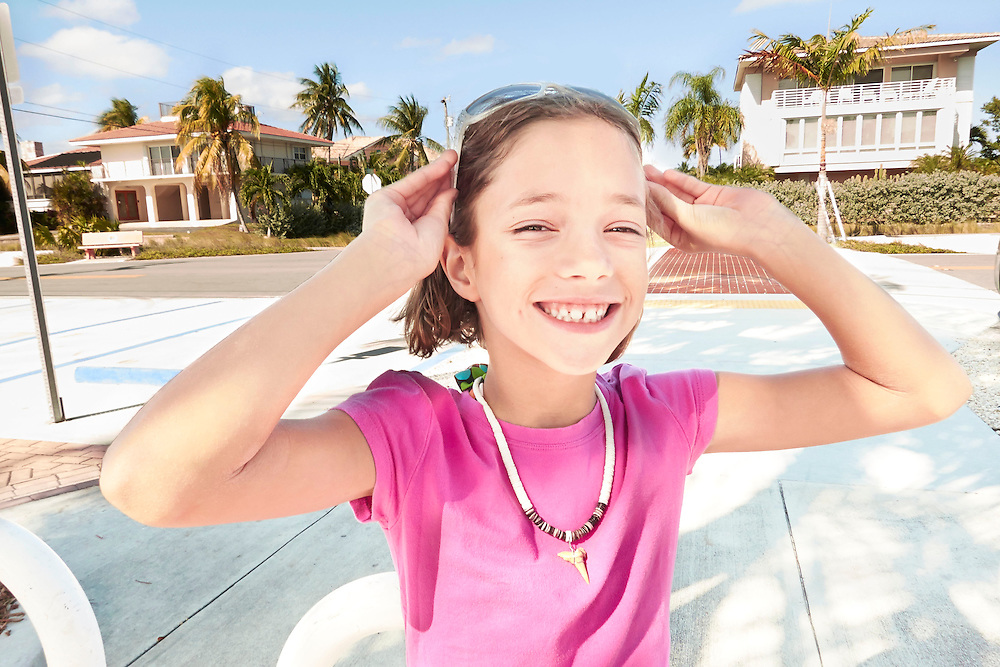 Lifestyle image of happy child with sunglasses in Key West Florida