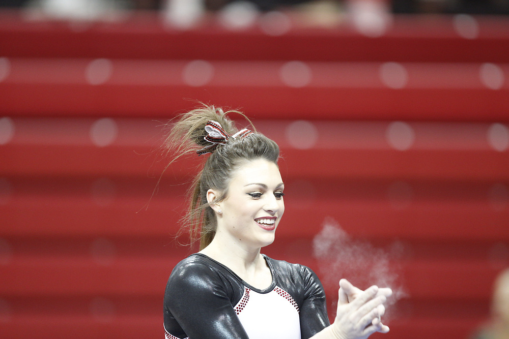 Madison McConkey celebrates after competing on the beam against Minnesota at the Bob Devaney Sports Center in Lincoln, Neb., on Feb. 12, 2016. Photo by Aaron Babcock, Hail Varsity