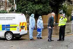 © Licensed to London News Pictures. 20/01/2021. London, UK. Forensic officers on West Green Road in Haringey, north London as police launch a murder investigation following the fatal stabbing of a teenage boy in Haringey. Police were called at 21:10hrs on Tuesday 19 January 2021 to the West Green Road junction with Willow Walk, following reports of a stabbing. Officers attended with the London Ambulance Service and found a male, aged 17, suffering from a stab injury. The victim was pronounced dead at 04:25hrs on Wednesday 20 January. . Photo credit: Dinendra Haria/LNP