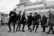 The Beatles arrive in Ireland to play their only gig in the country in the Adelphi Cinema on 7 November 1963. Alongside the Fab Four is radio & TV personality Paul Russell  (left), with Frank Hall appearing on the right of the picture.   .01.11.1963