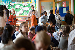 Children leaving classroom after school assembly,