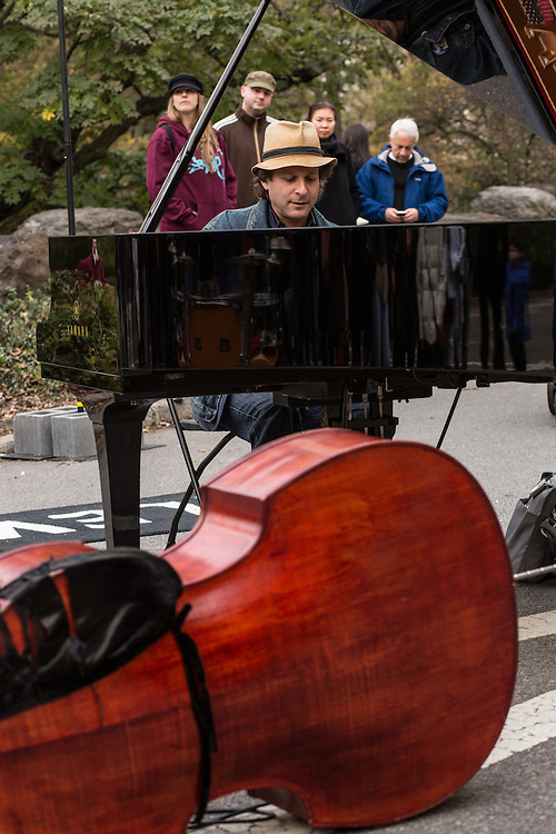 Eli Yamin, a New York musician, singer, bandleader and composer, plays blues in the break between the formal sets.