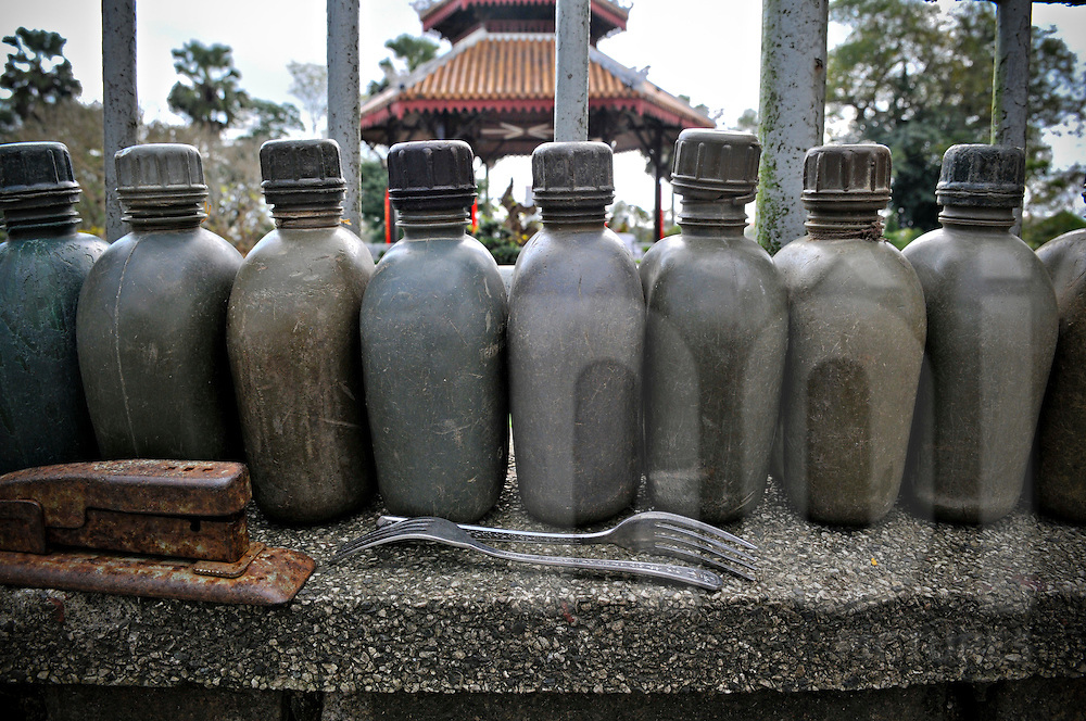 War relics are aligned on a window sil, Hue, Vietnam, Southeast Asia
